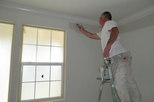Worker Cutting In Interior Paint