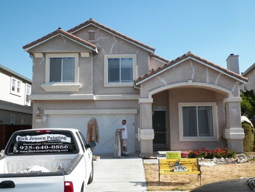 Before Two Story Stucco
